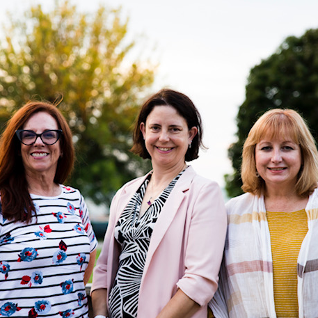 Three (white women) engineers on Canadian National Exhibition Association Board pose for a photo
