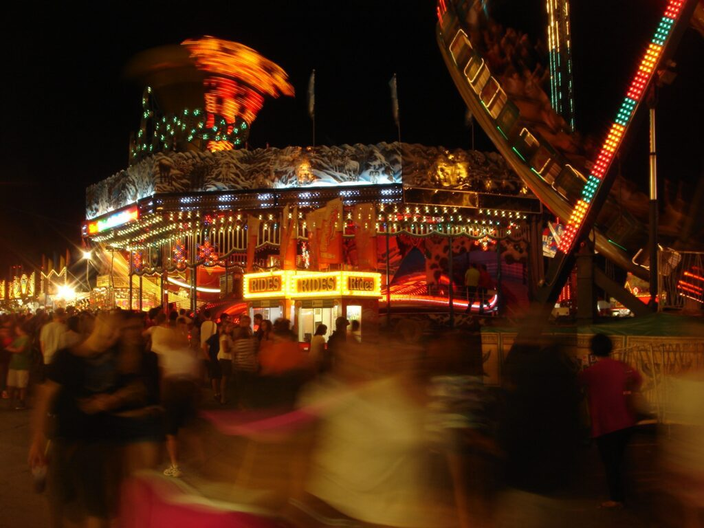 night-time midway scenes with blurred lights; decorative